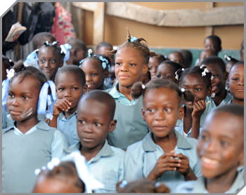 A large crowd of Haitian children in matching school uniforms