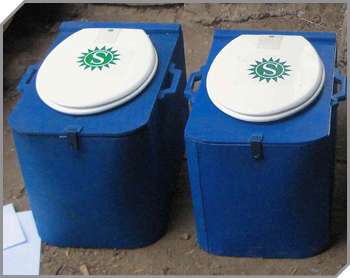 2 blue box shaped sanitation toilets in a row
