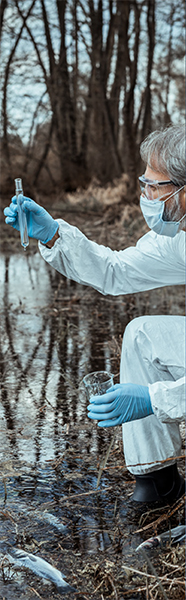 A scientist testing dirty water at a lake