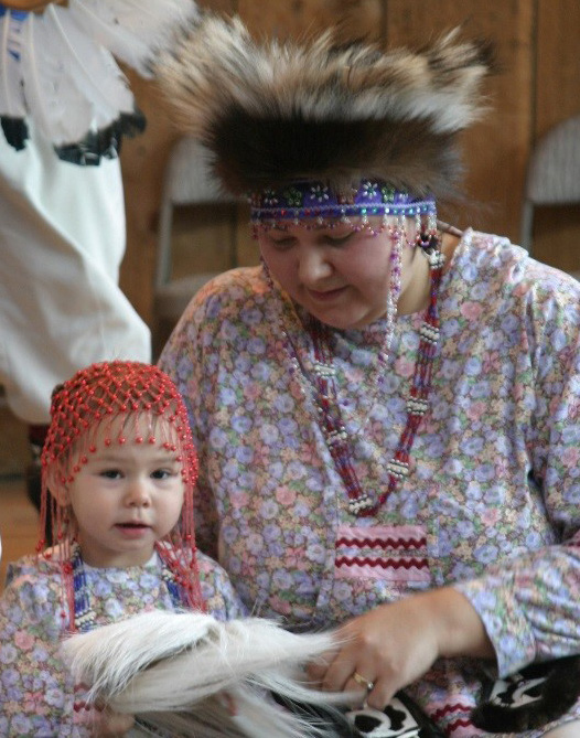 Native Alaskan residents with woman and her child