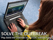 An image of a woman playing the Solve the Outbreak app on a laptop.