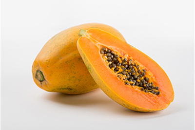 Two papayas with one cut in half