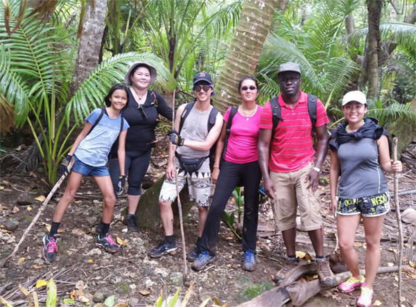 Susan Cha (DSTDP, EIS 2016) (far right) and Winston Abara (DVH, EIS 2015) (second from right) taking a break from an Epi-Aid to explore the Old Spanish Bridge in Agat, Guam (photo courtesy of Susan Cha)
