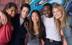 Photo of a smiling group of teenagers
