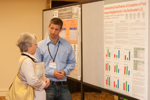A student researcher presents his poster at the 2012 National Conference on Health Statistics Poster Session.