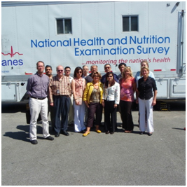 Informatics Branch staff in front of the Mobile Examination Center