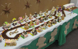 picture of gingerbread houses and MEC trailer made of cake