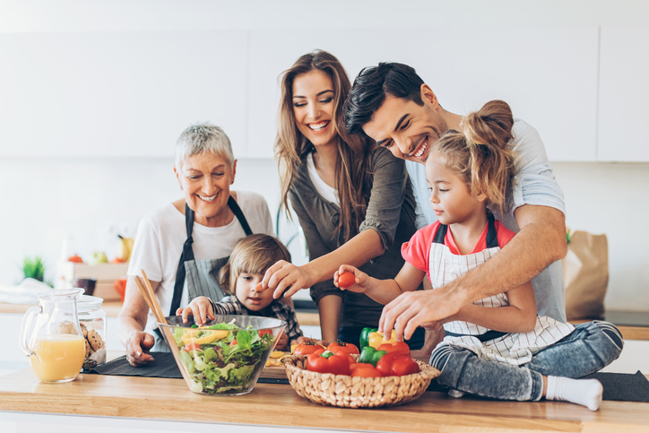 Image of family cooking together