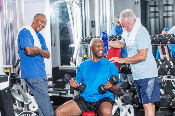 Image of older men working out together in a gym