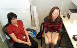 image of staff sitting in cubicle talking