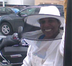 Photo of Claressa Lucas in a bee keepers suit