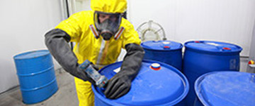 worker in a yellow hazmat suit