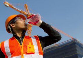 construction worker taking a drink