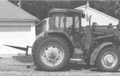 Photo 2: tractor with rear and bale spear