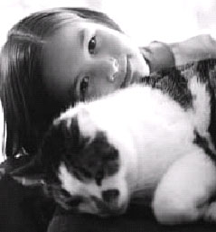 Youth with pet cat.