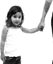 image of young girl holding hand of someone with a tatto on their forearm