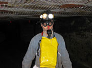 Miner wearing CCER (closed-circuit escape respirator)