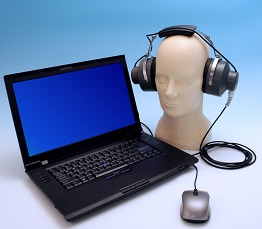 NIOSH HPD Well-Fit™ fit-testing system for earplugs shown with laptop and manikin with headphones.