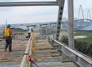 Bridge deck construction with wooden catch platforms.