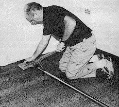 Figure 2. image of a carpet layer using a power stretcher