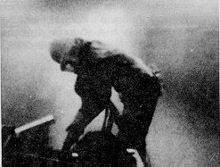 Figure 1. Sandblaster working in the dusty atmosphere created by airborne particles of silica sand