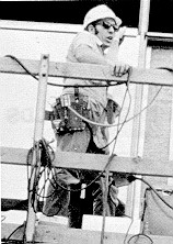 Figure 1. Worker with fall protection systems in place