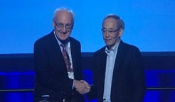Dr. Turkevich being congratulated by Dr. Steven Chu (president, AAAS).