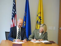 NIOSH Director, Dr. John Howard and ASSE President Terrie Norris, sign the agreement