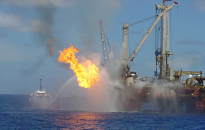 a picture of a burning oil vessel at sea