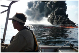 Response worker on one of the igniter vessels involved in a surface oil burn in the Gulf