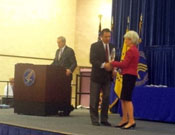 Tim receives his award from Secretary Sebelius