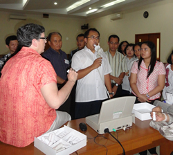 A physician participates in the practicum session of spirometry training.