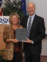 NIOSH Director Dr. John Howard presents Dr. Linda Rosenstock with the James P. Keogh Award.