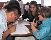 3 people conducting an assessment
