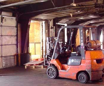 Figure 1. Forklift driven by decedent on dock