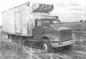 straight side produce truck partially loaded