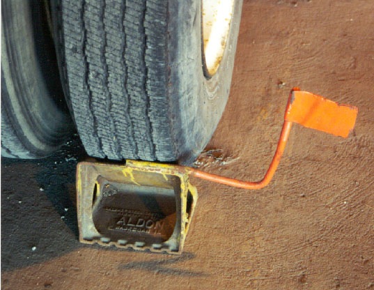 Wheel Chocks With a Flag. Metal flag welded onto a metal chock allows for greater visibility.