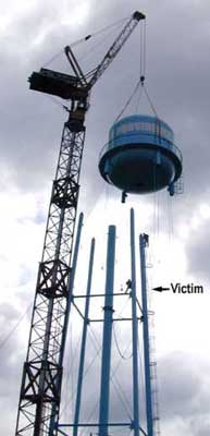 Photo 1 -- Picture of water tower taken a few minutes before the incident. (Photo credit--Marshalltown Times Republican)