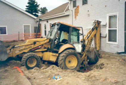 Figure 1 - Backhoe inside the excavation