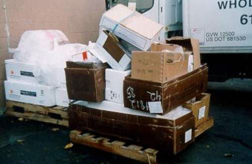 photo of wooden pallet loaded  with empty cardboard boxes similar to the load at the time of hte incident