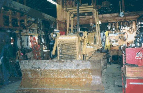 Figure 1 - Bulldozer involved in the incident, inside the blacksmith shop