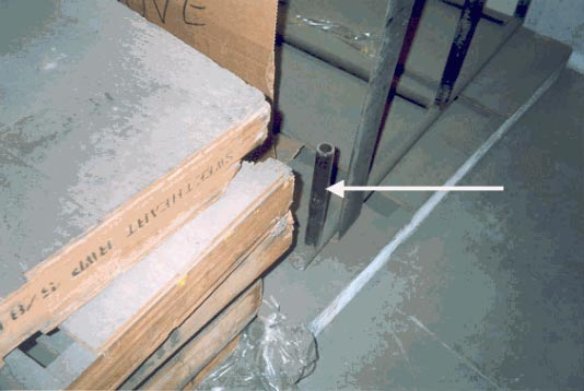Figure 5 - L-shaped metal tubing that slid into the same opening in the pallet as the order picker tines connecting the guardrail to the pallet.