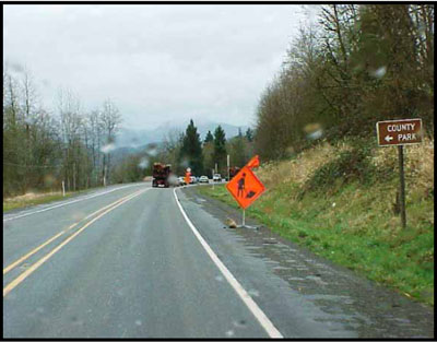 work zone signs traveling eastbound heading toward the incident site which is just beyond the curve on the highway