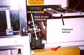 Photo 2. Gap in guarding showing chipboard remover.