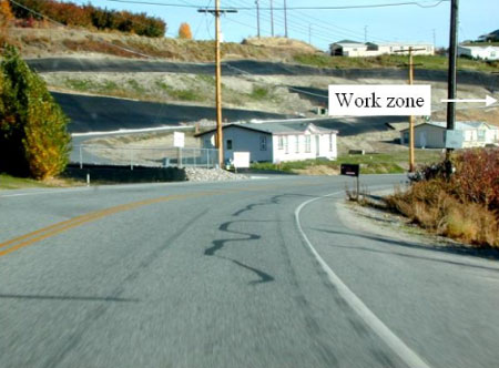 Photograph 1. View approaching the work zone from the south (direction from which the intruding vehicle approached).