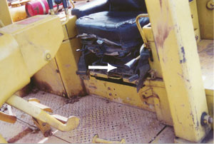 arrow points to the transmission neutral safety lock, the buldozer is ready for  movement