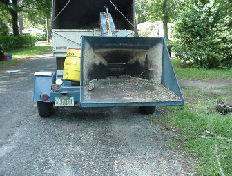 Feed chute of wood chipper.