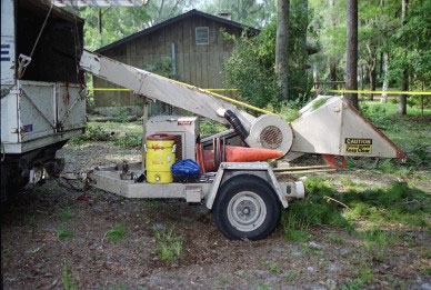 Side view of wood chipper.