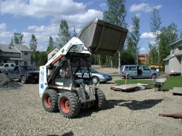 Figure 1. Skid-steer loader with raised bucket