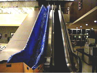 Exhibit #1. View of the escalators running between the lobby and second floor of the courthouse. The escalator on the left was involved in the incident.